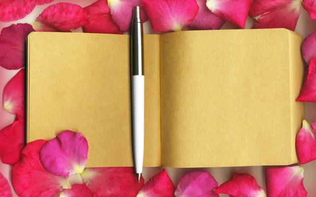 Rose-petal with notebook.